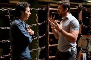 REAL STEEL director SHAWN LEVY and star HUGH JACKMAN discuss a scene on set at Crash Palace.