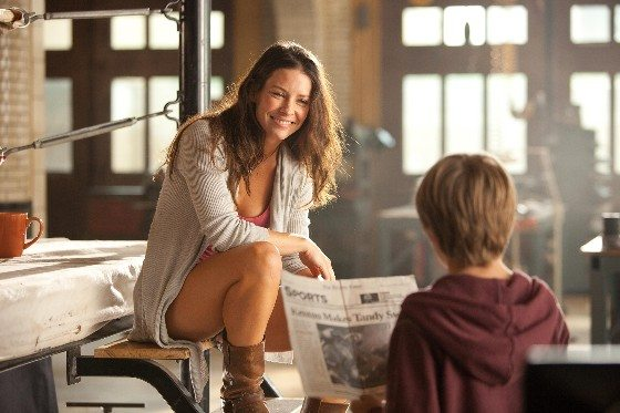 Bailey Tallet (Evangeline Lilly) tells Max (Dakota Goyo) that, as a boxer, his father, Charlie Kenton, was the top contender, number 2 in the world, in a scene from REAL STEEL.  Photo Credit:  DreamWorks - used with permission