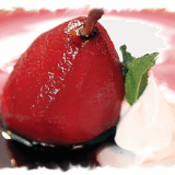 Glazed Poached Pears with Pudding Filling and Whipped Cream