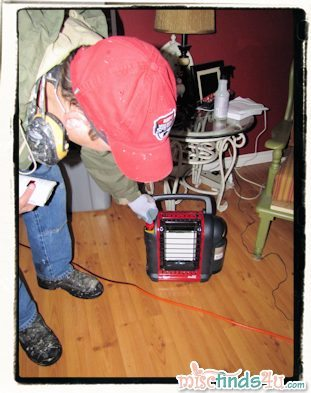 Setting up the new propane heater rated for indoor use during our last power outage