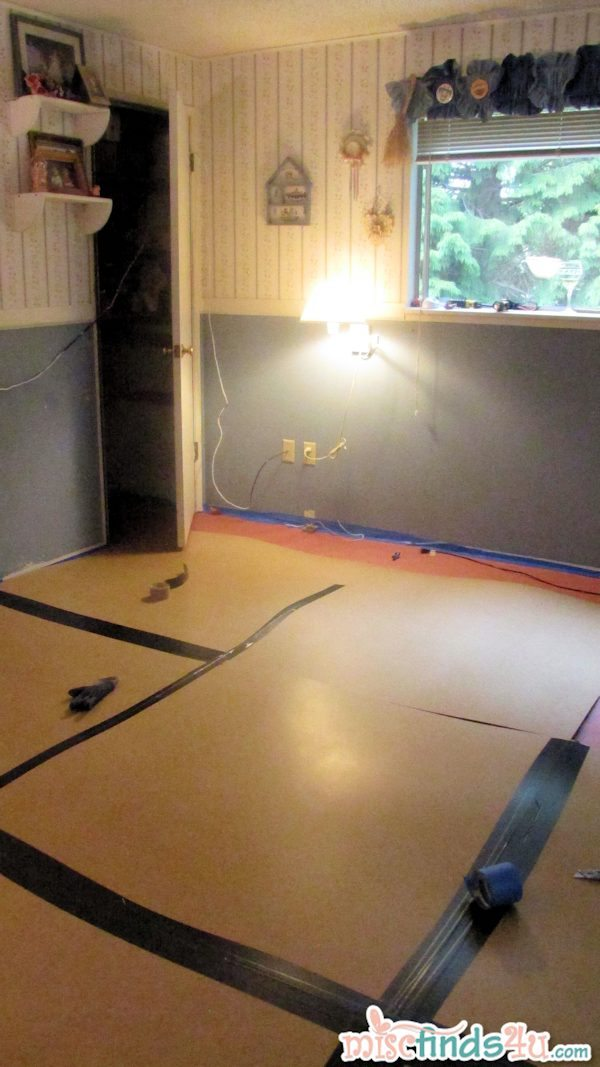 We covered the floor in two layers - lightweight boards taped together to protect the new flooring underneath and then a layer of plastic.