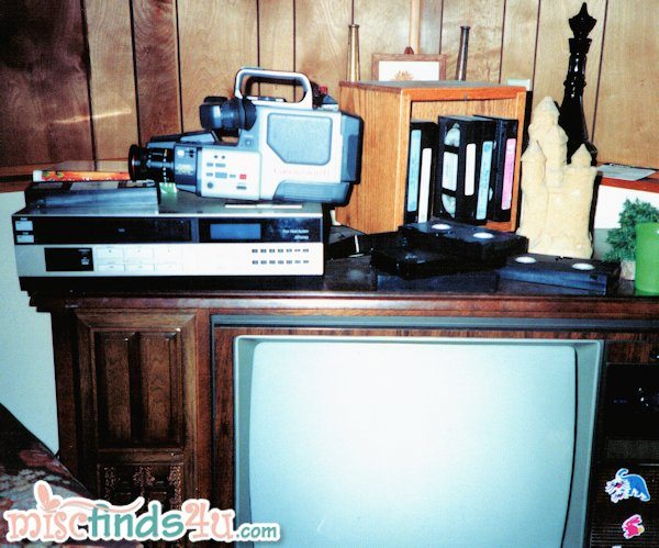 1990's video camera, VHS recorder, and console TV