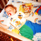 Alex about 1 year old with his books - 1988