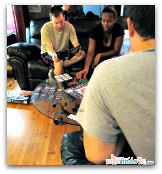 "Our ""kids"" playing a game in the living room. #Cbias #momcave"