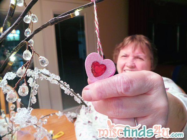Mom showing off one of the 3D jeweled hearts that became inexpensive DIY ornaments