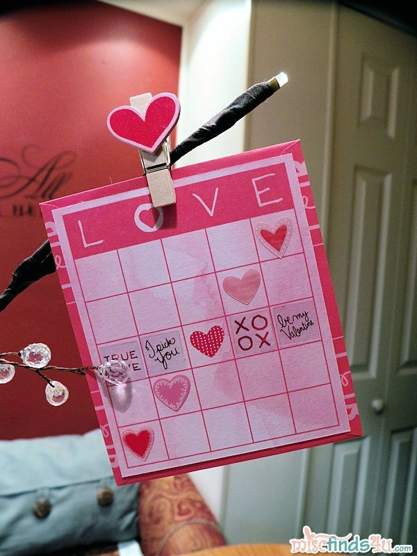 Valentine mounted on envelope and then pinned on the tree with a decorative clothes pin