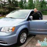The hubby checking out the 2013 Chrysler Town & Country Minivan we're taking on the road this weekend