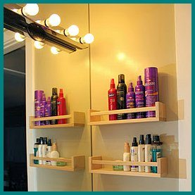 Ikea spice racks used for bathroom storage by Suite Revival
