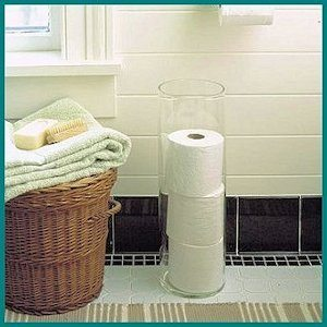 Use a vase to hold extra rolls of toilet paper - Martha Stewart
