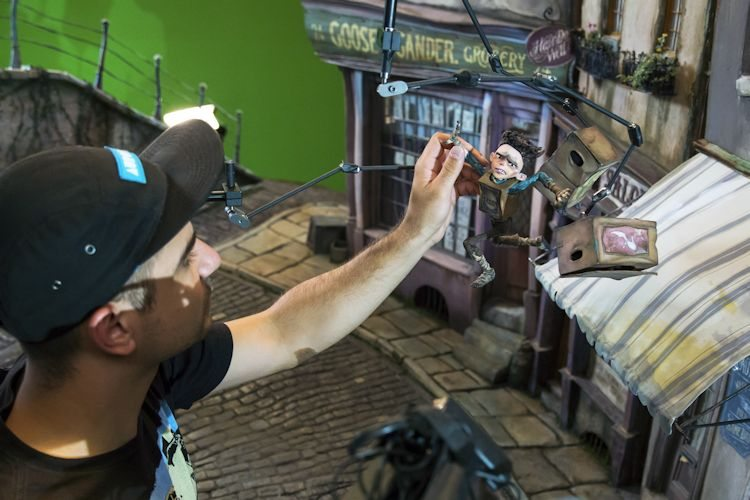 Danail Kraev works on the Eggs puppet (held with rigging) during production of LAIKA and Focus Features' family event movie THE BOXTROLLS, opening nationwide September 26th. Credit:  John Leonhardt / LAIKA, Inc.