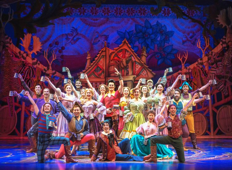 Tim Rogan as Gaston and the cast of Disney's Beauty and the Beast. Photo by Amy Boyle. Beauty and the Beast National Tour Seattle  Beauty and the Beast National Tour Seattle  ad