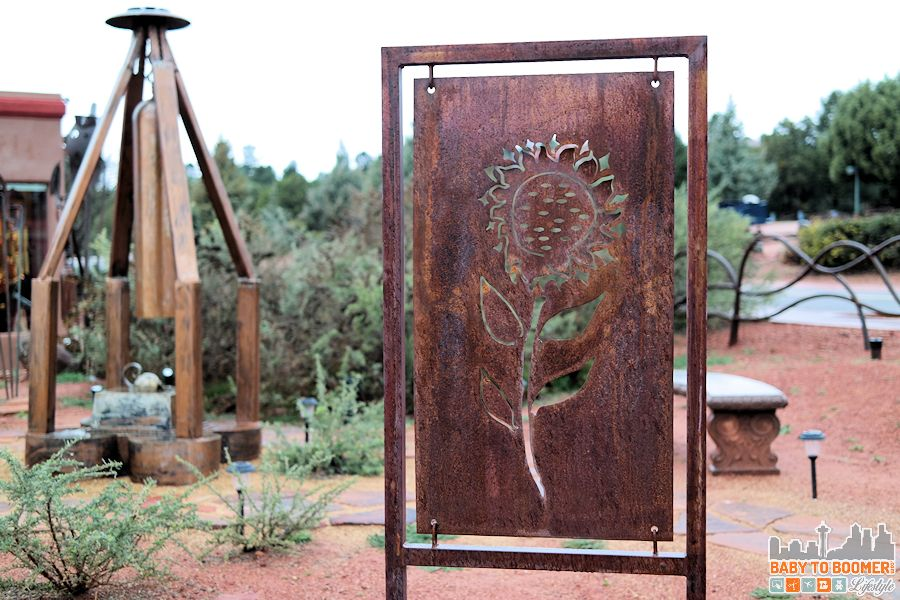 Sedona Art: The metal garden panels, decorative fence, as well as the custom Gallery doors were created by Steve Goldenstein from hand-forged iron.