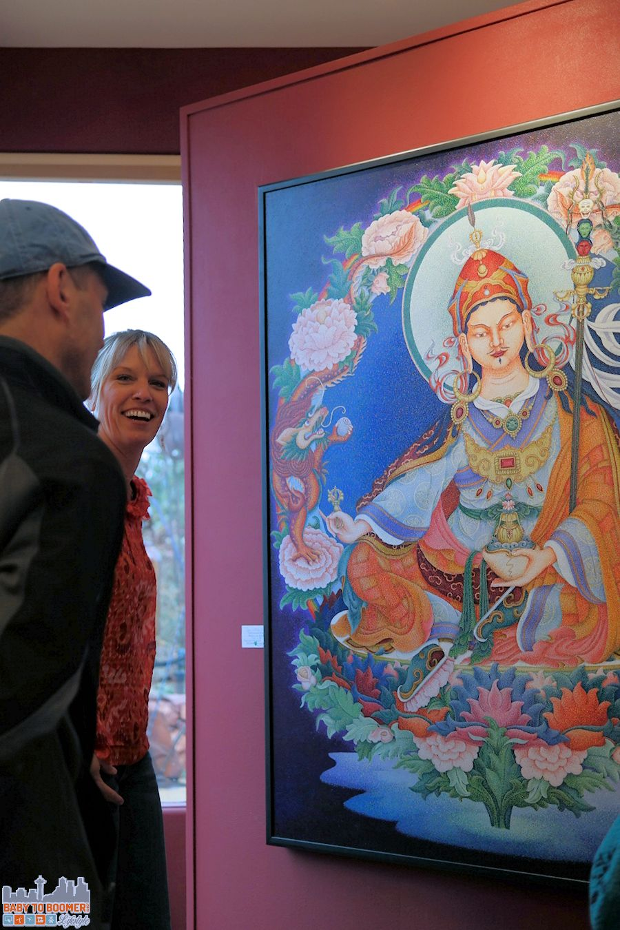 Sedona Art: A gallery staff member shares the pointillist artwork of artist in residence, Sherab Khandro.