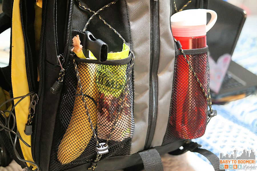 My carry on bag is packed with healthy snacks and a reusable water bottle with a filter. - Travel Packing Tips: Pack to Stay Healthy While Traveling #FindYourHealthy ad