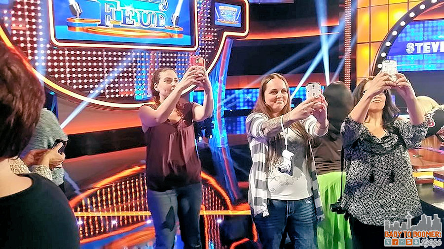 Bloggers on the set of Family Feud - a trio of selfie-taking bloggers