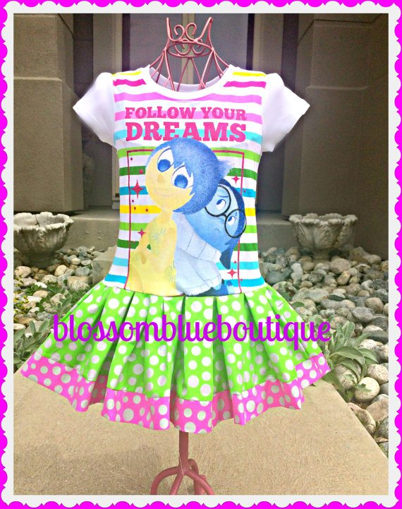 "Too much color? NO! Stripes, polka dots, and stars with an important message to ""Follow Your Dreams"". This handmade dress from a t-shirt highlights the relationship between Joy and Sadness. You can purchase this dress at Blossom Blue Boutique."