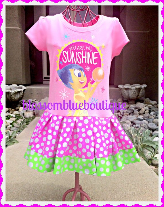 "I love the coordinating fabric skirt! This ""Your Are My Sunshine"" t-shirt features Joy from the Disney