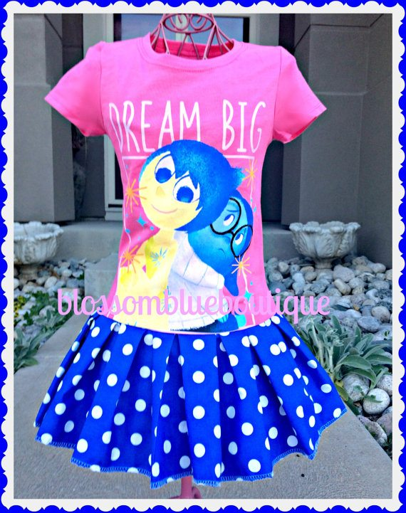 Dream Big party dress created from an INSIDE OUT t-shirt with a blue and white polka dot skirt added. A great play dress! Available at Blossom Blue Boutique.