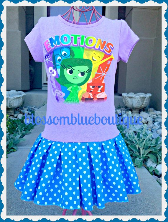 This purple INSIDE OUT t-shirt features all five of the emotions - Joy, Anger, Sadness, Fear, and Disgust - is sweetened with a blue and white polka dot skirt. Available from Blossom Blue Boutique.