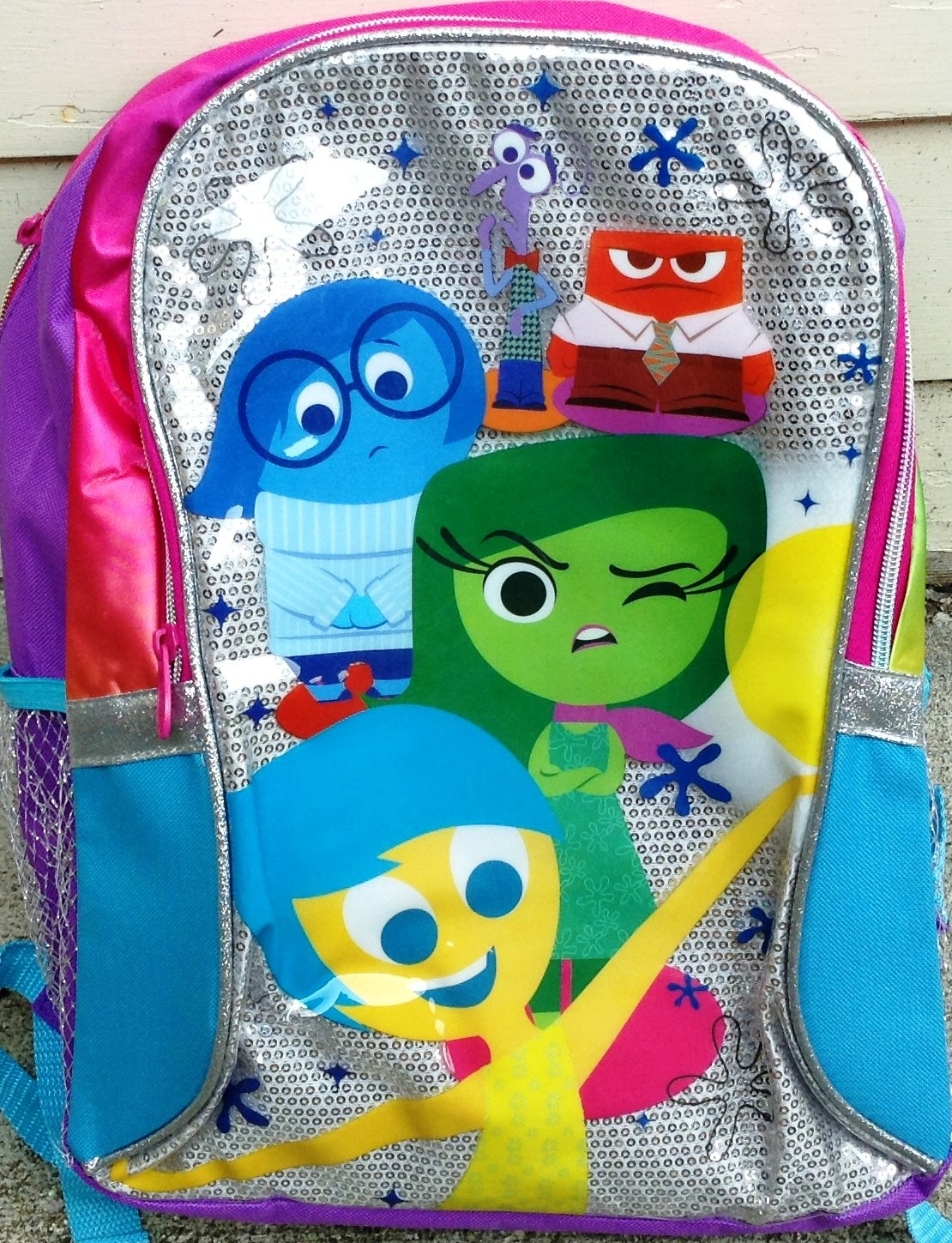 INSIDE OUT Sparkle Backpack features Joy, Disgust, Sadness, Fear, and Anger - the whole crew! Pink, purple, teal, and silver accents.