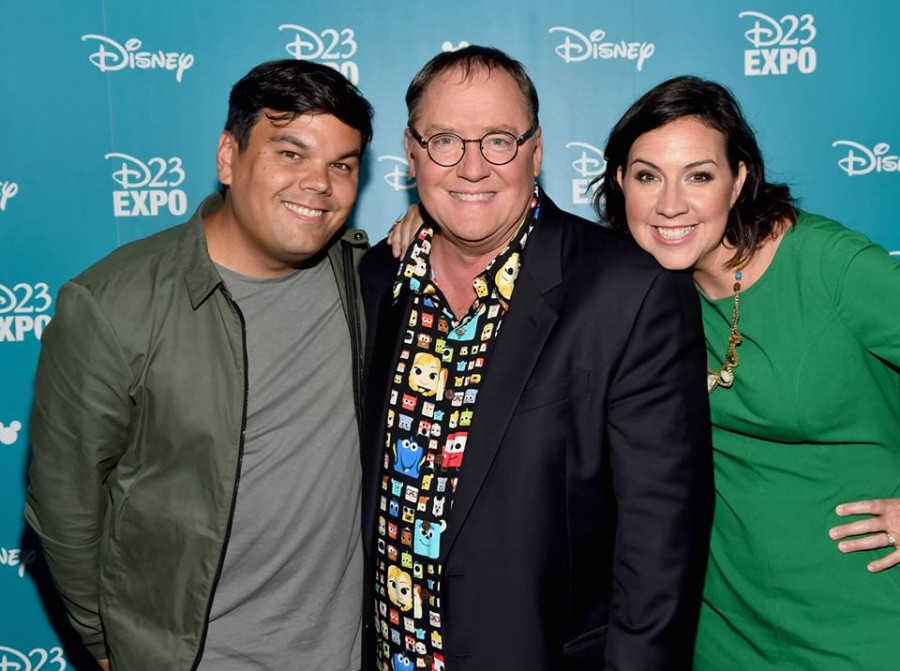 """Songwriters Bobby Lopez (L) and Kristen Anderson-Lopez (R) of GIGANTIC with Chief Creative Officer of Walt Disney and Pixar Animation Studios John Lasseter (C) took part today in """"Pixar and Walt Disney Animation Studios: The Upcoming Films"""" presentation at Disney's D23 EXPO 2015 in Anaheim, Calif."""