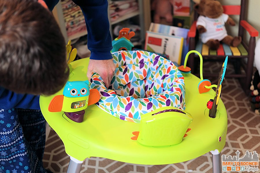 ad Must-Have Baby Gear - Oribel PortaPlay Convertible Activity Center - snapping the seat in place
