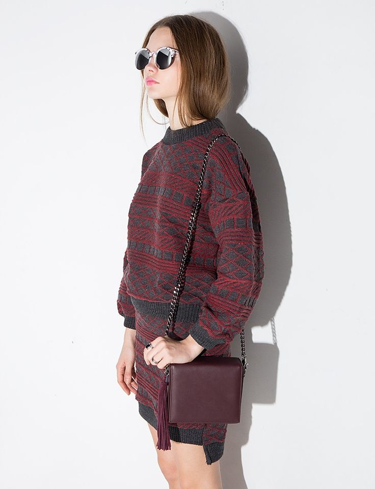 """Pixie Market - Boxy burgundy cross body bag with gunmetal chain shoulder strap and tassel fringe. Snap button closure. 100% faux leather. Measures 6"""" by 7"""". Online price $82"""