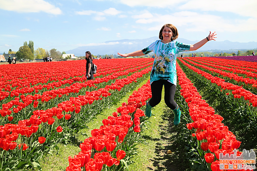 Jumping for Joy - RoozenGaarde Tulip Field 2016 - Spring and Fall 2016 Boot Trends: Western and Chooka Boots #TulipBoots ad