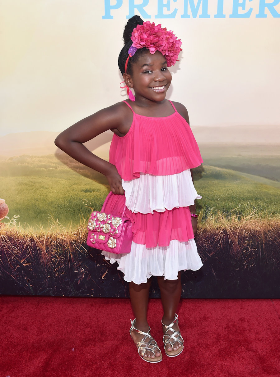 "HOLLYWOOD, CA - JUNE 21: Actress Trinitee Stokes arrives on the red carpet for the US premiere of Disney's ""The BFG,"" directed and produced by Steven Spielberg. A giant sized crowd lined the streets of Hollywood Boulevard to see stars arrive at the El Capitan Theatre. ""The BFG"" opens in U.S. theaters on July 1, 2016, the year that marks the 100th anniversary of Dahl's birth, at the El Capitan Theatre on June 21, 2016 in Hollywood, California. (Photo by Alberto E. Rodriguez/Getty Images for Disney) *** Local Caption *** Trinitee Stokes #TheBFGEvent"
