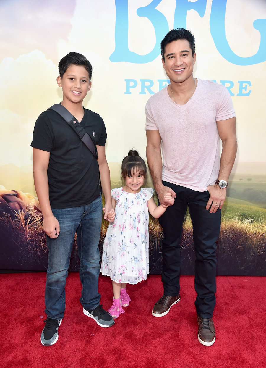 "HOLLYWOOD, CA - JUNE 21: TV personality Mario Lopez (R) and daughter Gia Francesca Lopez (C) and guest arrive on the red carpet for the US premiere of Disney's ""The BFG,"" directed and produced by Steven Spielberg. A giant sized crowd lined the streets of Hollywood Boulevard to see stars arrive at the El Capitan Theatre. ""The BFG"" opens in U.S. theaters on July 1, 2016, the year that marks the 100th anniversary of Dahl's birth, at the El Capitan Theatre on June 21, 2016 in Hollywood, California. (Photo by Alberto E. Rodriguez/Getty Images for Disney) *** Local Caption *** Mario Lopez; Gia Francesca Lopez"