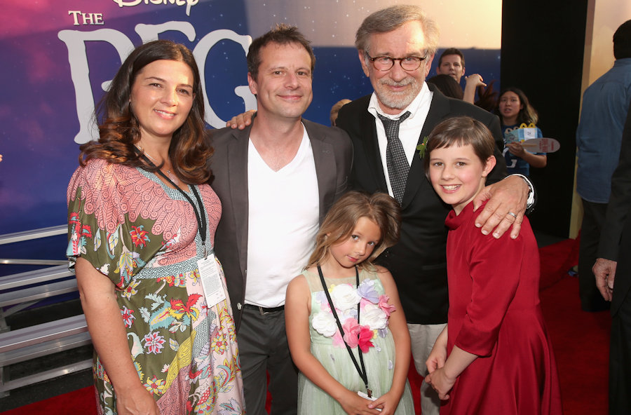 "HOLLYWOOD, CA - JUNE 21: Director Steven Spielberg (2nd R), actress Ruby Barnhill and family arrive on the red carpet for the US premiere of Disney's ""The BFG,"" directed and produced by Steven Spielberg. A giant sized crowd lined the streets of Hollywood Boulevard to see stars arrive at the El Capitan Theatre. ""The BFG"" opens in U.S. theaters on July 1, 2016, the year that marks the 100th anniversary of Dahl's birth, at the El Capitan Theatre on June 21, 2016 in Hollywood, California. (Photo by Jesse Grant/Getty Images for Disney) *** Local Caption *** Steven Spielberg; Ruby Barnhill #TheBFGEvent"