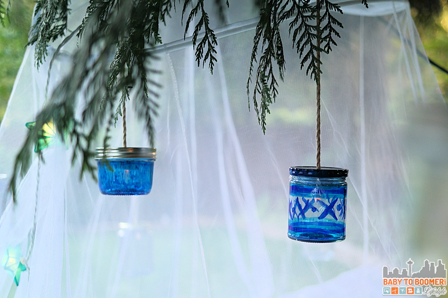 Hanging the lanterns -Msg 4 21+: Glamping Make Your Own Marker Lanterns #ShareWine #CollectiveBias #ad