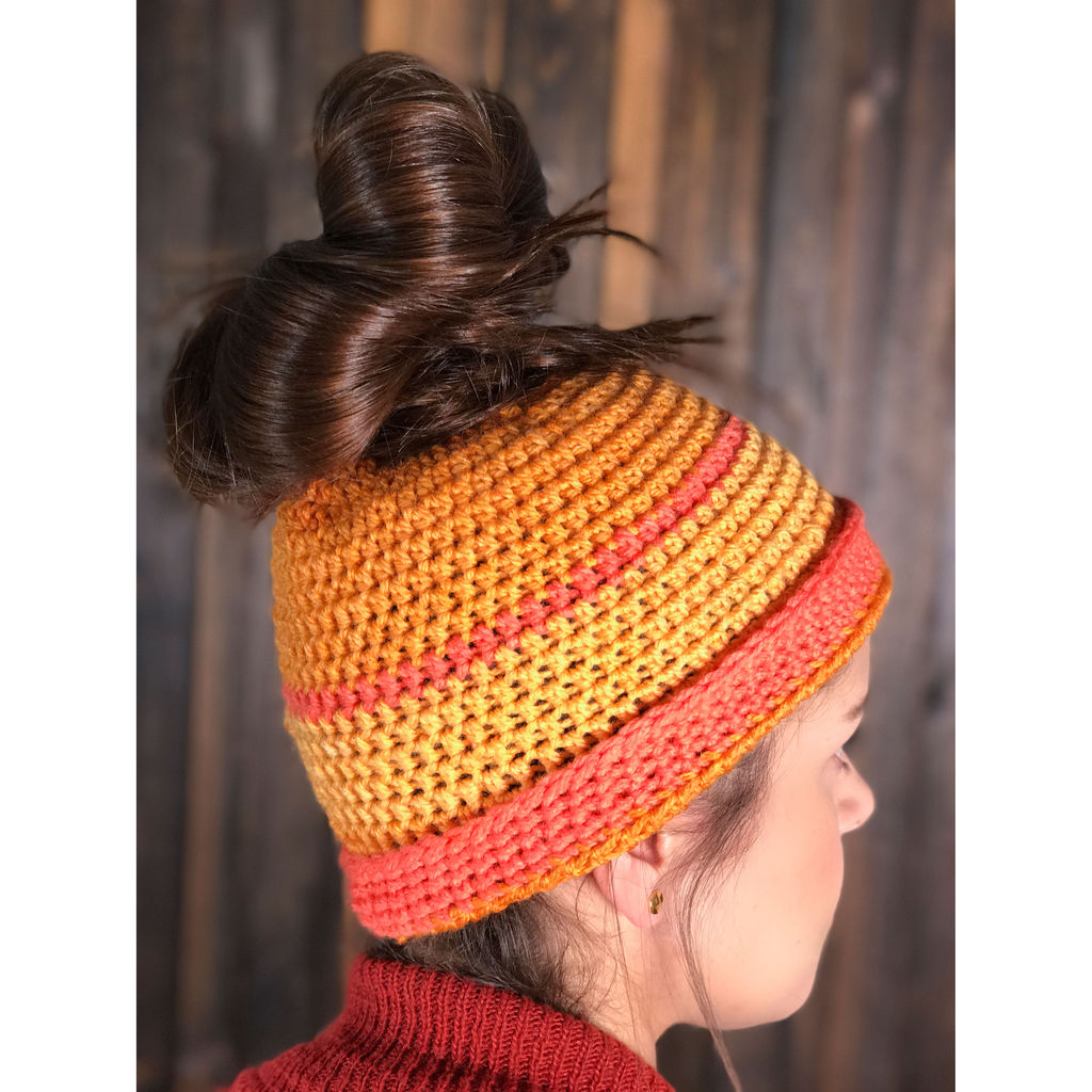 Get this free messy bun hat crochet pattern and find more free patterns that feature Caron Cakes Spice Cake Yarn (New color for 2017!!)