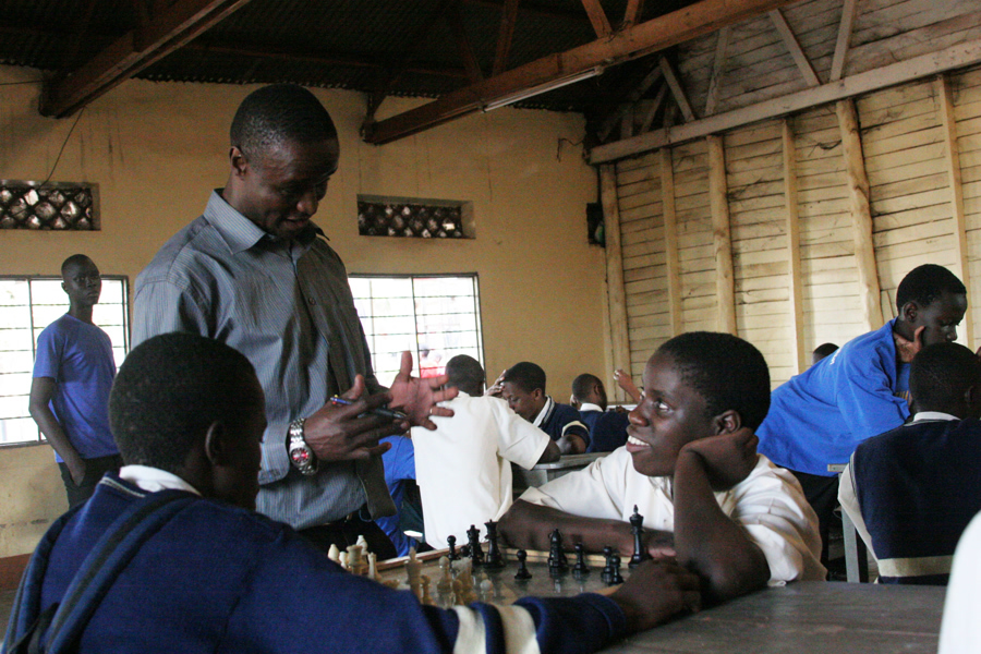 Robert Katende and Phiona Mutesi at Robert's chess program