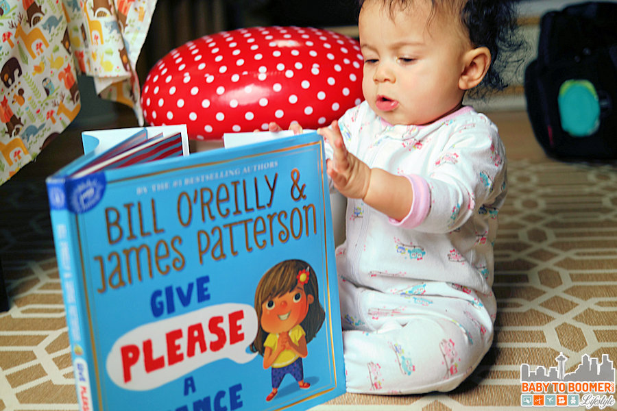 You can never start kids on the adventure of reading too early! Ame - 8 months old reading with Daddy - Give Please A Chance: Teaching Kids About Manners in an Engaging Way #GivePleaseaChance #ad
