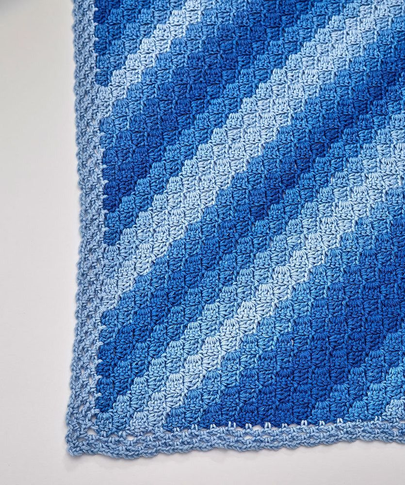 Free Crochet Pattern featuring Red Heart Ombre Yarn in True Blue - c2c throw