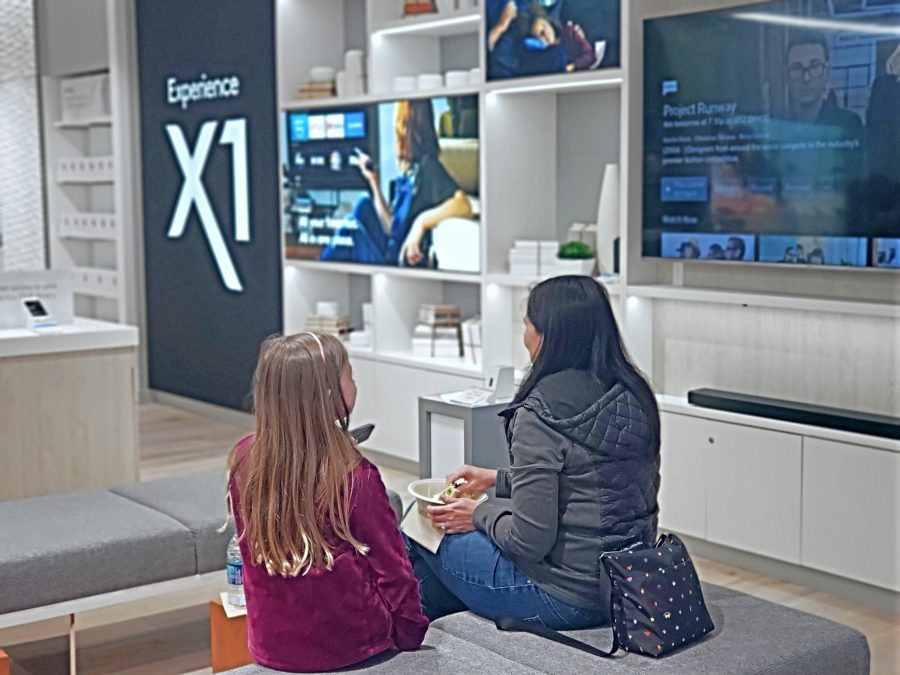 A mom and her daughter check out the X1 Experience Zone at the Bellevue Square Xfinity Store by Comcast
