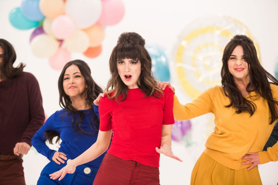 Kat Decker (played by Laura Marano) with back-up dancers in a dream sequence. Photo credit: © 2019 Warner Bros. Entertainment Inc.
